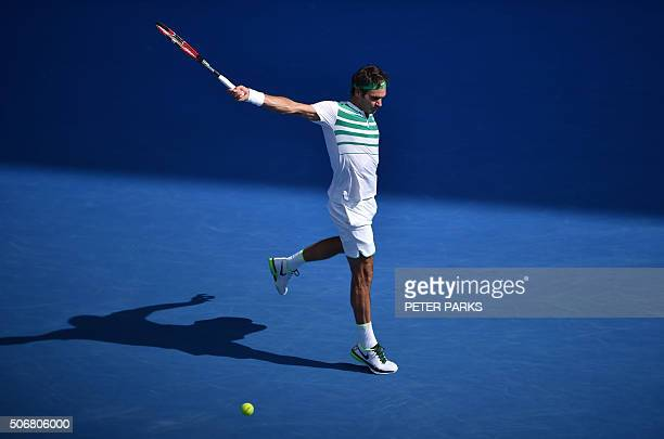 TOPSHOT Switzerland's Roger Federer plays a backhand return during his men's singles match against Czech Republic's Tomas Berdych on day nine of the...