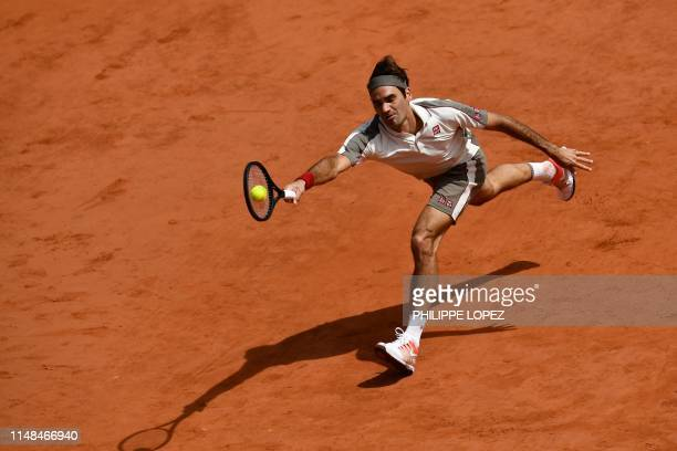 Switzerland's Roger Federer plays a forehand return to Spain's Rafael Nadal during their men's singles semi-final match on day 13 of The Roland...