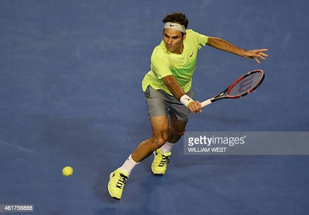 Switzerland's Roger Federer plays a shot during his men's singles match against Taiwan's Lu YenHsun on day one of the 2015 Australian Open tennis...
