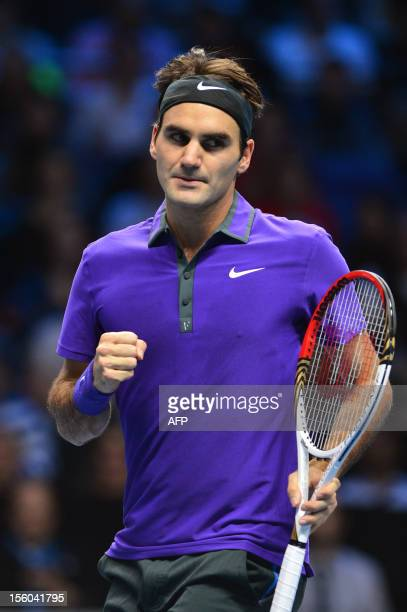 Switzerland's Roger Federer pumps his fist after breaking the serve of Britain's Andy Murray in the first set of their semifinal singles match on the...