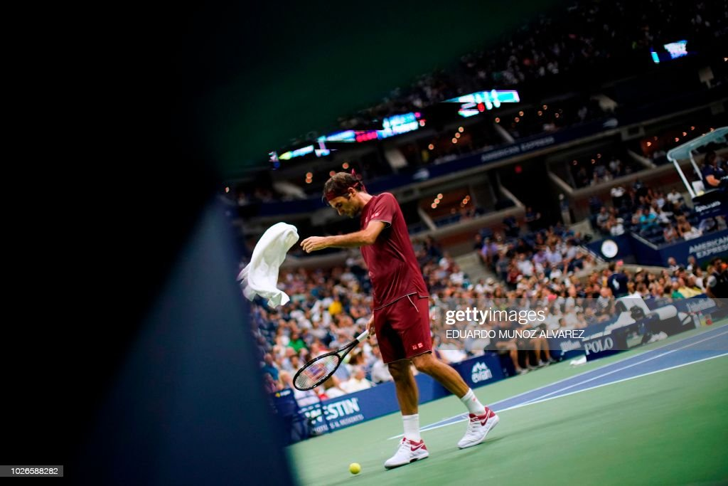 TOPSHOT - Switzerland's Roger Federer reaches for a towel after losing a point to Australia's John Millman during their 2018 US Open Men's Singles tennis match at the USTA Billie Jean King National Tennis Center in New York on September 3, 2018.