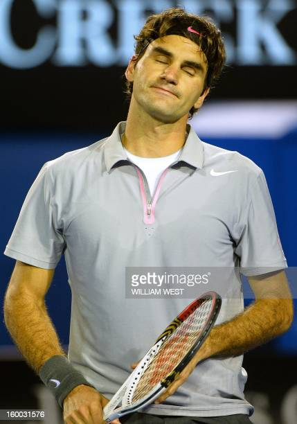 Switzerland's Roger Federer reacts after a point against Britain's Andy Murray during their men's singles semifinal match on day 12 of the Australian...