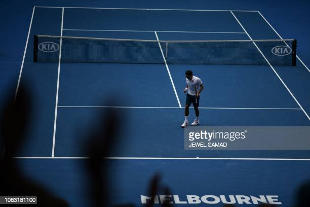 Switzerland's Roger Federer reacts after a point against Britain's Daniel Evans during their men's singles match on day three of the Australian Open...