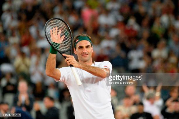 TOPSHOT Switzerland's Roger Federer reacts after his victory against Spain's Rafael Nadal during their tennis match at The Match in Africa at the...