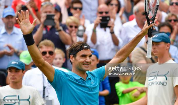 Switzerland's Roger Federer reacts after winning the final match against Canada's Milos Raonic at the ATP Mercedes Cup tennis tournament in...