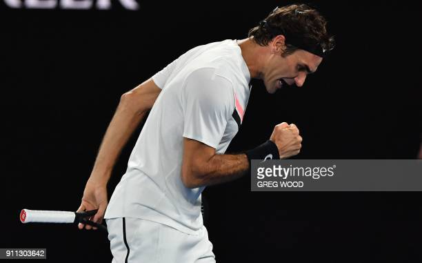 Switzerland's Roger Federer reacts against Croatia's Marin Cilic during their men's singles final match on day 14 of the Australian Open tennis...