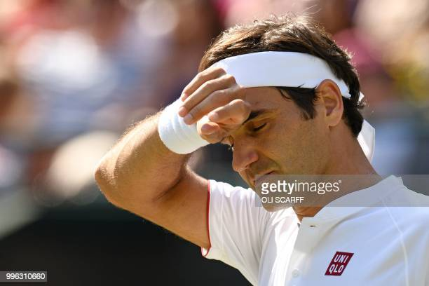 Switzerland's Roger Federer reacts against South Africa's Kevin Anderson during their men's singles quarterfinals match on the ninth day of the 2018...
