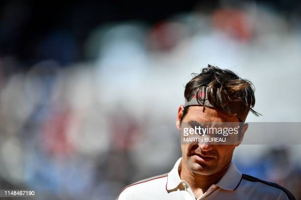 Switzerland's Roger Federer reacts as he plays against Spain's Rafael Nadal during their men's singles semifinal match on day 13 of The Roland Garros...