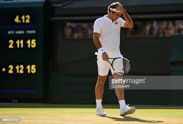 Switzerland's Roger Federer reacts as he plays South Africa's Kevin Anderson in their men's singles quarterfinals match on the ninth day of the 2018...