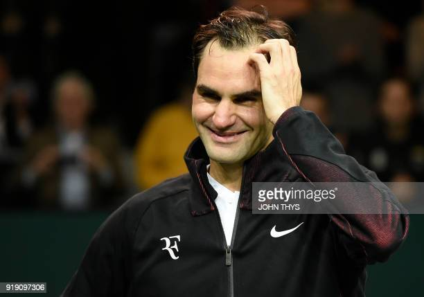Switzerland's Roger Federer reacts as he speaks to the audience after victory over Netherlands Robin Haase in their quarterfinal singles tennis match...