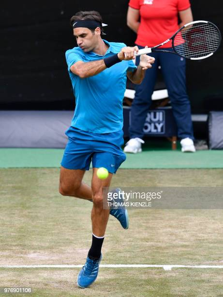 Switzerland's Roger Federer returnes the ball to Canada's Milos Raonic during the final match at the ATP Mercedes Cup tennis tournament in Stuttgart...