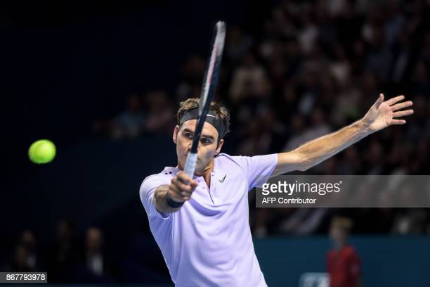 Switzerland's Roger Federer returns a ball to Argentina's Juan Martin Del Potro during their final tennis match at the Swiss Indoors ATP 500 tennis...