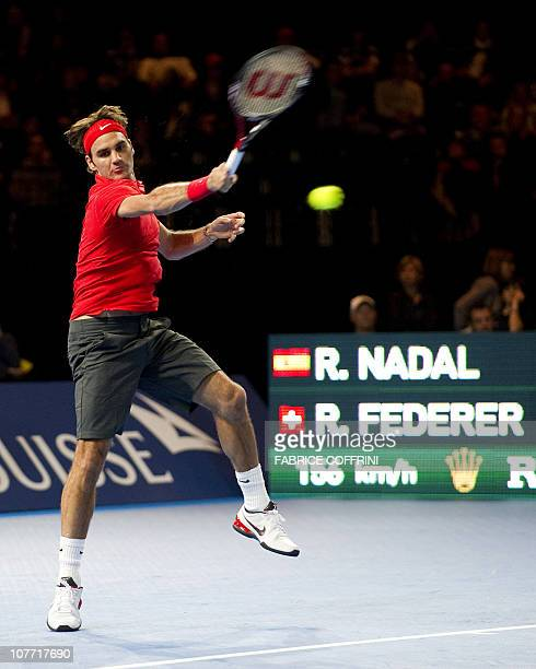 Switzerland's Roger Federer returns a ball to Spain's Rafael Nadal during a charity tennis game on December 21 2010 in Zurich The Match for Africa...