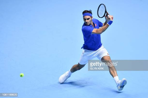 Switzerland's Roger Federer returns against Austria's Dominic Thiem during their men's singles roundrobin match on day three of the ATP World Tour...
