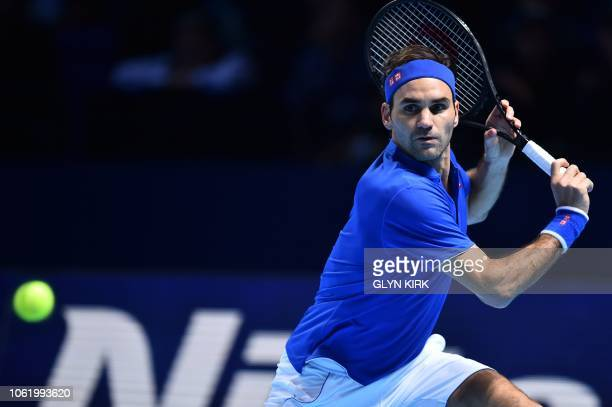 Switzerland's Roger Federer returns against South Africa's Kevin Anderson in their men's singles roundrobin match on day five of the ATP World Tour...