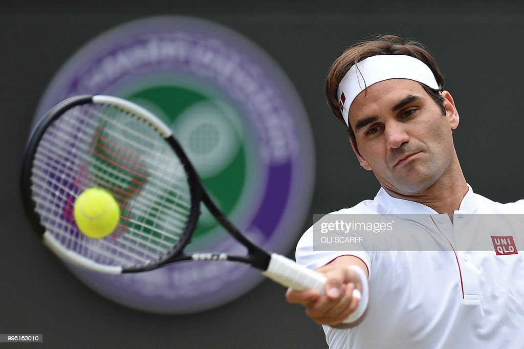 Switzerland's Roger Federer returns against South Africa's Kevin Anderson during their men's singles quarter-finals match on the ninth day of the 2018 Wimbledon Championships at The All England Lawn Tennis Club in Wimbledon, southwest London, on July 11, 2018. (Photo by Oli SCARFF / AFP) / RESTRICTED