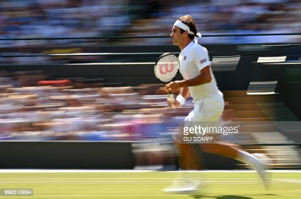 TOPSHOT Switzerland's Roger Federer returns against South Africa's Kevin Anderson during their men's singles quarterfinals match on the ninth day of...