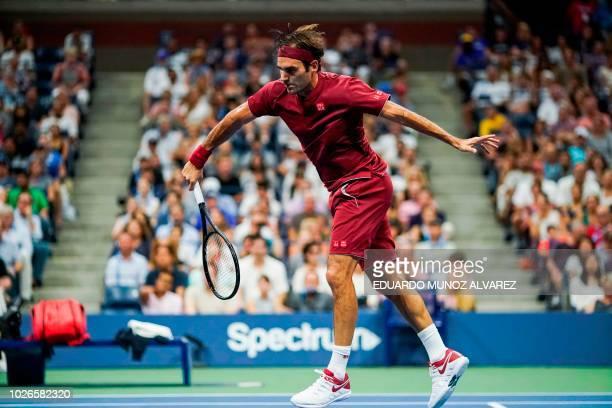 Switzerland's Roger Federer returns the ball to Australia's John Millman during their 2018 US Open Men's Singles tennis match at the USTA Billie Jean...