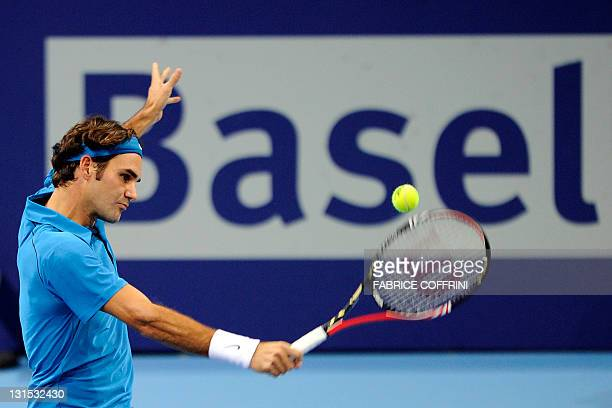 Switzerland's Roger Federer returns the ball to compatriot Stanislas Wawrinka erer on November 5 2011 during their Swiss Indoors ATP tennis...