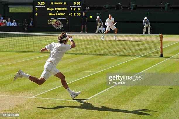 Switzerland's Roger Federer returns to Canada's Milos Raonic during their men's singles semifinal match on day 11 of the 2014 Wimbledon Championships...