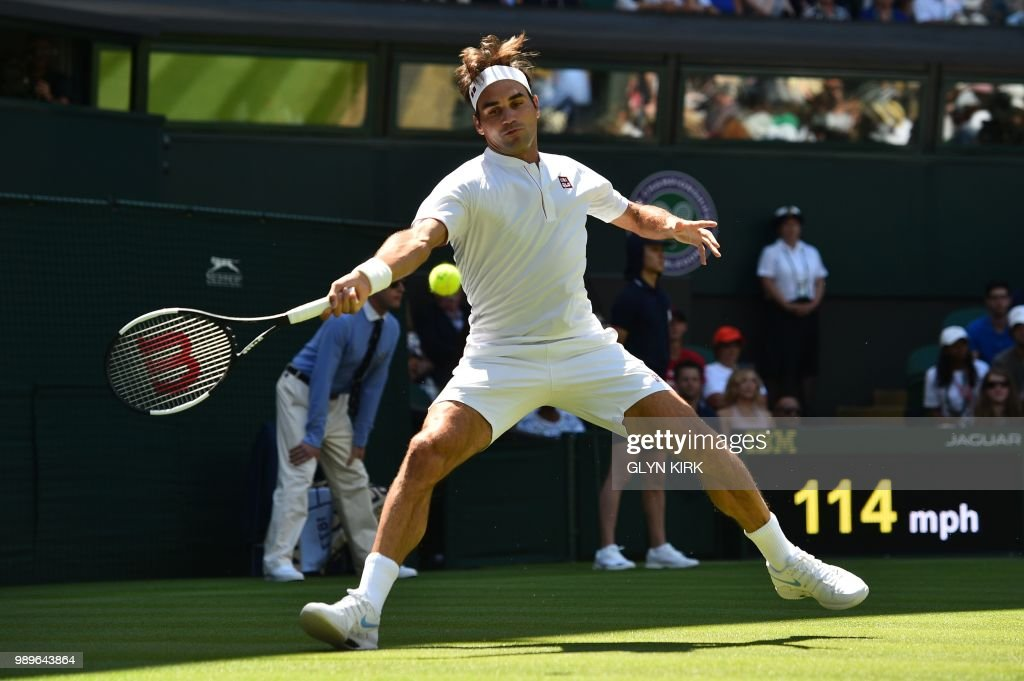 Switzerland's Roger Federer returns to Serbia's Dusan Lajovic during their men's singles first round match on the first day of the 2018 Wimbledon Championships at The All England Lawn Tennis Club in Wimbledon, southwest London, on July 2, 2018. (Photo by Glyn KIRK / AFP) / RESTRICTED