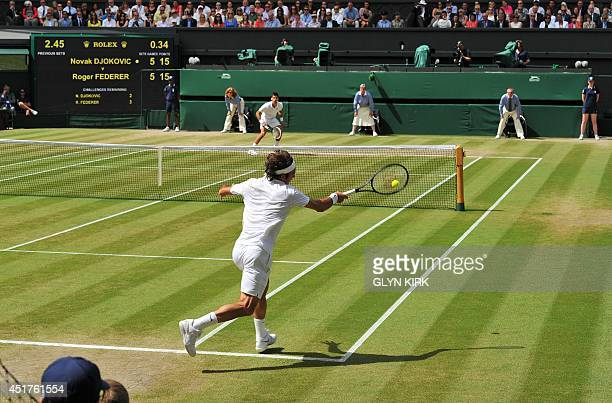 Switzerland's Roger Federer returns to Serbia's Novak Djokovic during their men's singles final match on day thirteen of the 2014 Wimbledon...