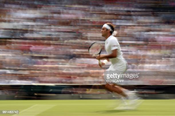 TOPSHOT Switzerland's Roger Federer runs to play a return against Slovakia's Lukas Lacko during their men's singles second round match on the third...