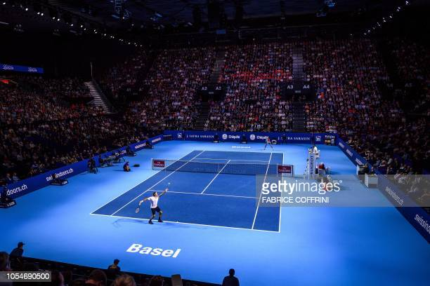 Switzerland's Roger Federer serves a ball to Romania's Marius Copil during their final match at the Swiss Indoors ATP 500 tennis tournament on...