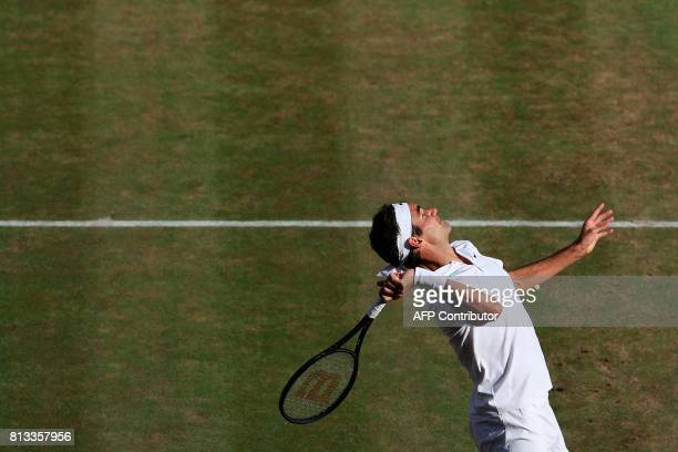 TOPSHOT Switzerland's Roger Federer serves against Canada's Milos Raonic in their men's singles quarterfinal match on the ninth day of the 2017...