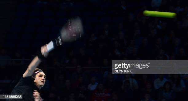 Switzerland's Roger Federer serves against Italy's Matteo Berrettini during their men's singles round-robin match on day three of the ATP World Tour...