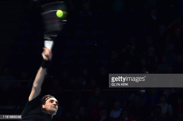 Switzerland's Roger Federer serves against Italy's Matteo Berrettini during their men's singles roundrobin match on day three of the ATP World Tour...