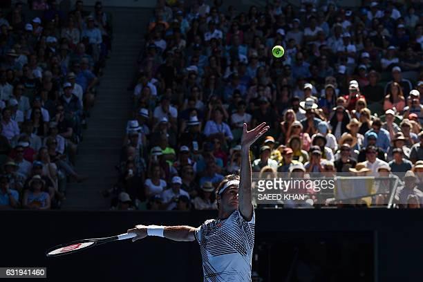 TOPSHOT Switzerland's Roger Federer serves against Noah Rubin of the US during their men's singles match on day three of the Australian Open tennis...