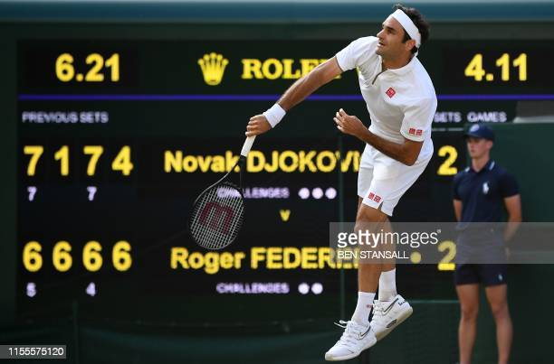 Switzerland's Roger Federer serves against Serbia's Novak Djokovic during the men's singles final on day thirteen of the 2019 Wimbledon Championships...