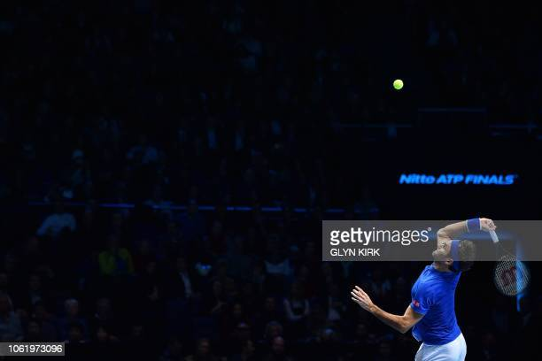 TOPSHOT Switzerland's Roger Federer serves against South Africa's Kevin Anderson in their men's singles roundrobin match on day five of the ATP World...