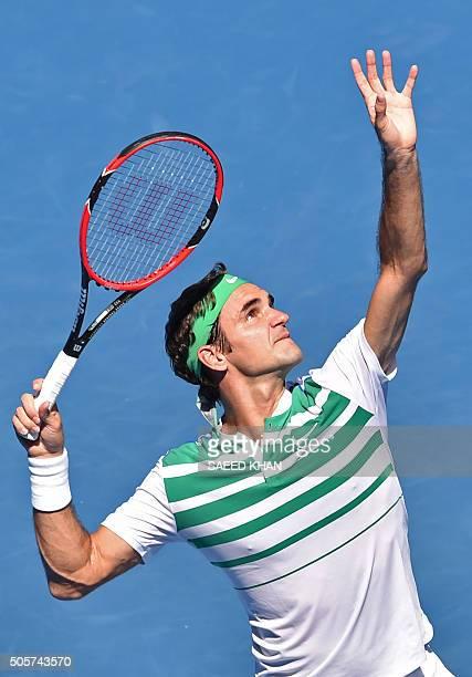 Switzerland's Roger Federer serves against Ukraine's Alexandr Dolgopolov during their men's singles match on day three of the 2016 Australian Open...
