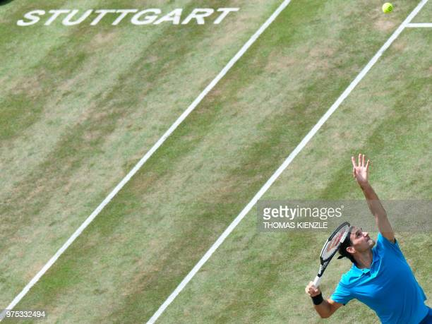 TOPSHOT Switzerland's Roger Federer serves the ball to Argentina's Guido Pella in their quarterfinal match at the ATP Mercedes Cup tennis tournament...