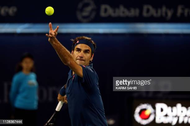 Switzerland's Roger Federer serves the ball to Greece's Stefanos Tsitsipas during the final match at the ATP Dubai Tennis Championship in the Gulf...