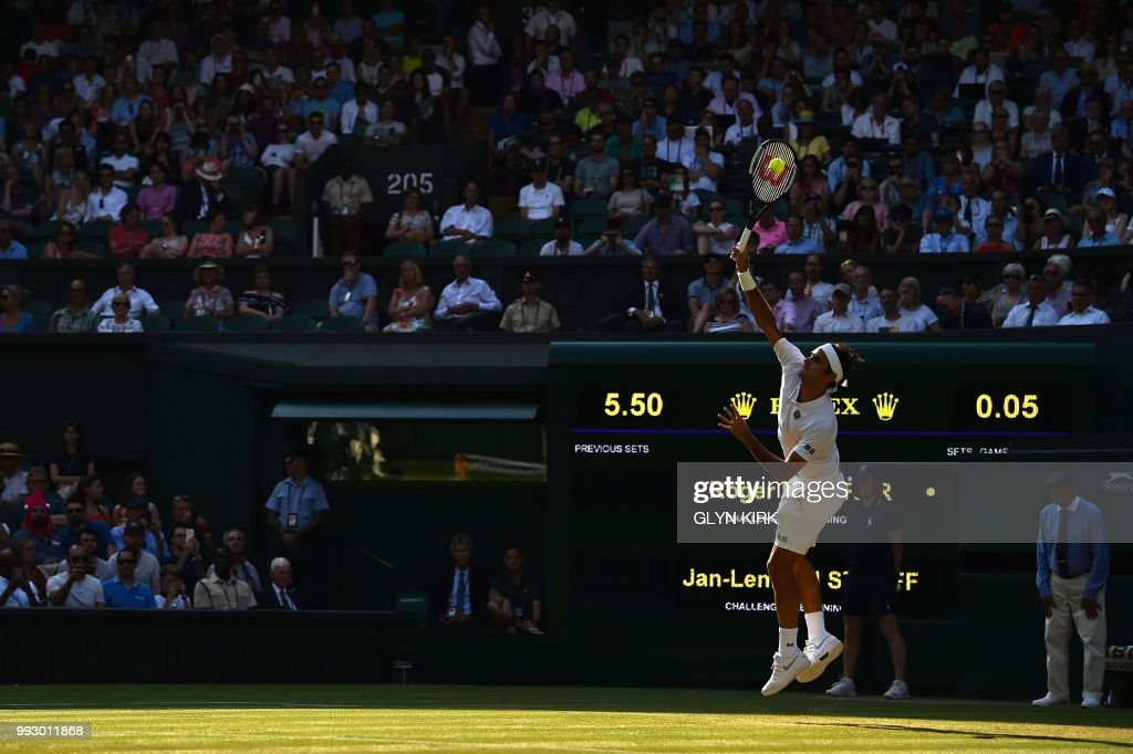 TOPSHOT - Switzerland's Roger Federer serves to Germany's Jan-Lennard Struff in their men's singles third round match on the fifth day of the 2018 Wimbledon Championships at The All England Lawn Tennis Club in Wimbledon, southwest London, on July 6, 2018. (Photo by Glyn KIRK / AFP) / RESTRICTED