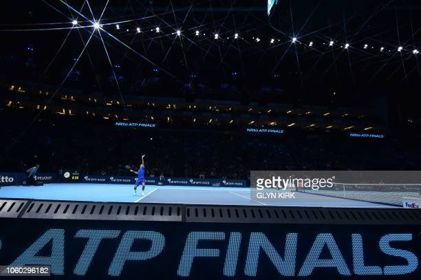 Switzerland's Roger Federer serves to Japan's Kei Nishikori during their singles round robin match on day one of the ATP World Tour Finals tennis...