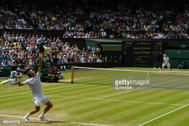 Switzerland's Roger Federer serves to Serbia's Novak Djokovic during their men's singles final match on Centre Court on day thirteen of the 2015...
