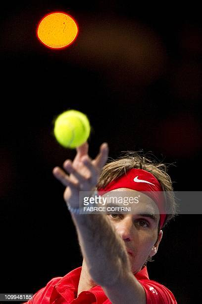 Switzerland's Roger Federer serves to Spain's Rafael Nadal during a charity tennis game on December 21 2010 in Zurich The Match for Africa is...