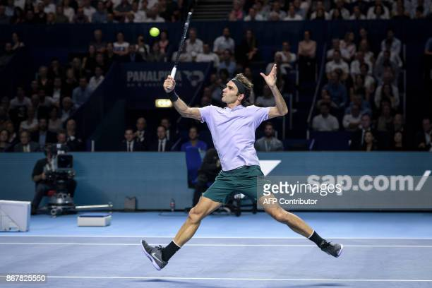 TOPSHOT Switzerland's Roger Federer smashs a ball to Argentina's Juan Martin Del Potro during their final tennis match at the Swiss Indoors ATP 500...
