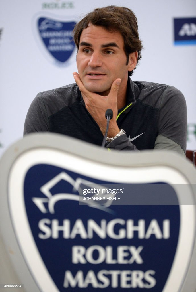 Switzerland's Roger Federer speaks during a press conference at the Shanghai Masters 1000 tennis tournament held in the Qizhong Tennis Stadium in Shanghai on October 5, 2014.