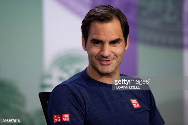 Switzerland's Roger Federer takes part in a press conference after losing to South Africa's Kevin Anderson 26 67 75 64 1311 in their men's singles...