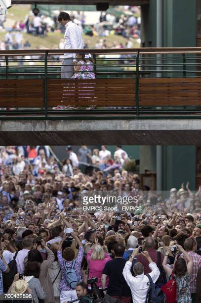 Switzerland's Roger Federer walks across a bridge with his daughters Charlene Riva and Myla Rose after losing the mens singles final