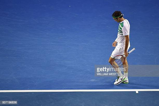 Switzerland's Roger Federer walks on court during his men's singles semifinal match against Serbia's Novak Djokovic on day eleven of the 2016...