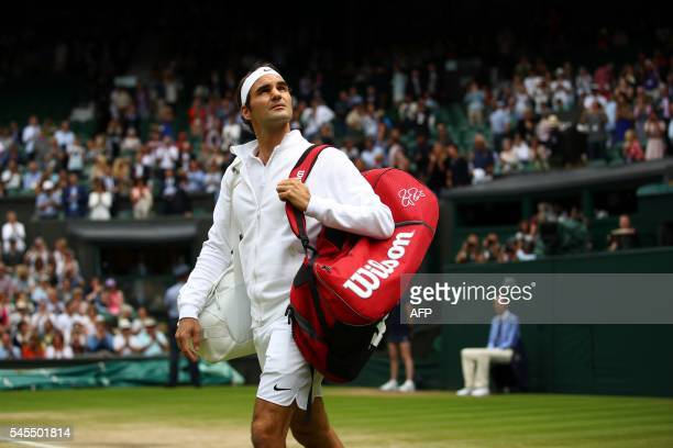 Switzerland's Roger Federer walks onto centre court to play Canada's Milos Raonic in their men's semifinal match on the twelfth day of the 2016...
