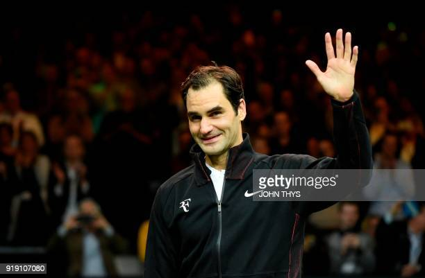 Switzerland's Roger Federer waves as he celebrates after victory over Netherlands Robin Haase in their quarterfinal singles tennis match for the ABN...