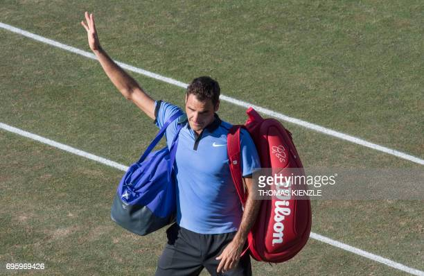 Switzerland's Roger Federer waves as he leaves the court after he lost against Germany's Tommy Haas in their round of sixteen match at the ATP...