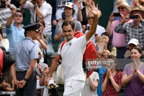 Switzerland's Roger Federer waves as he leaves the court after winning against Slovakia's Lukas Lacko during their men's singles second round match...